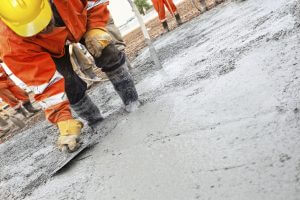 workers curing concrete in winter